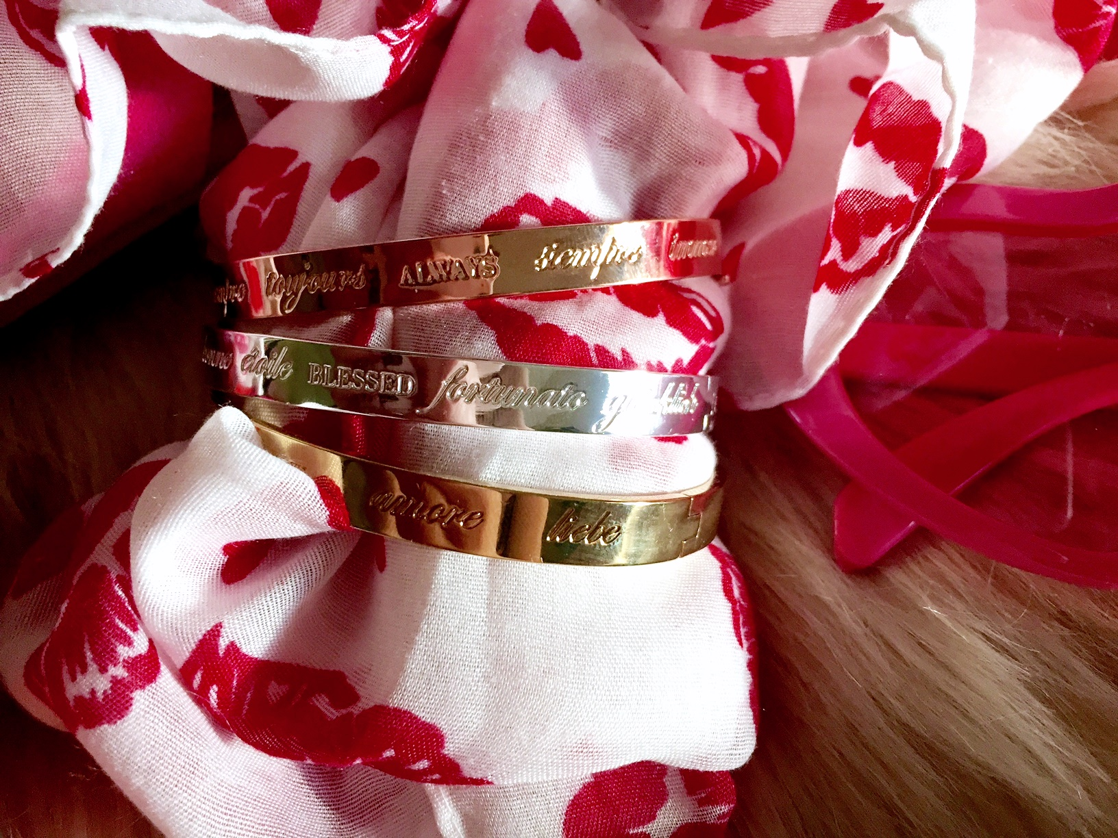 Love, Always, and Blessed bangles in different languages.