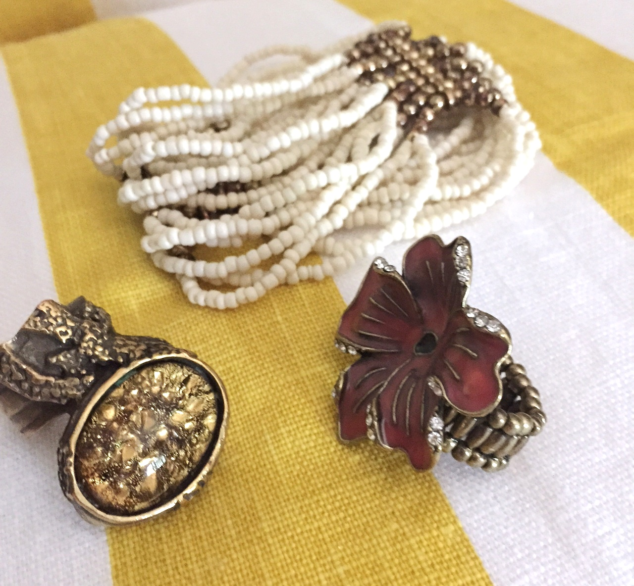 Texture and a gold tone on all the standout separate pieces help to tie the look together.